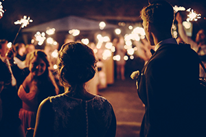 Couple at outdoor party.