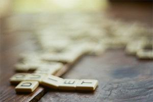 """Scrabble board with the word """"quiet"""" spelt."""