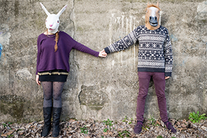 Couple wearing animal masks.