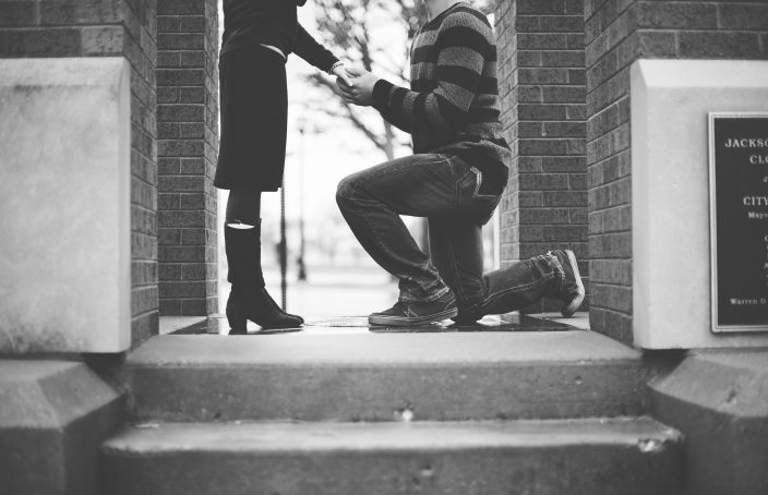 Man on one knee proposing to his girlfriend