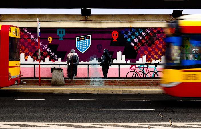 Graffiti couple at bus station.