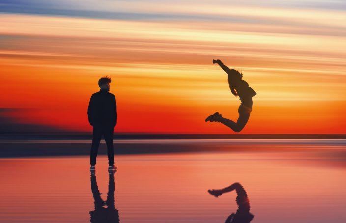 woman-jumping-sunset