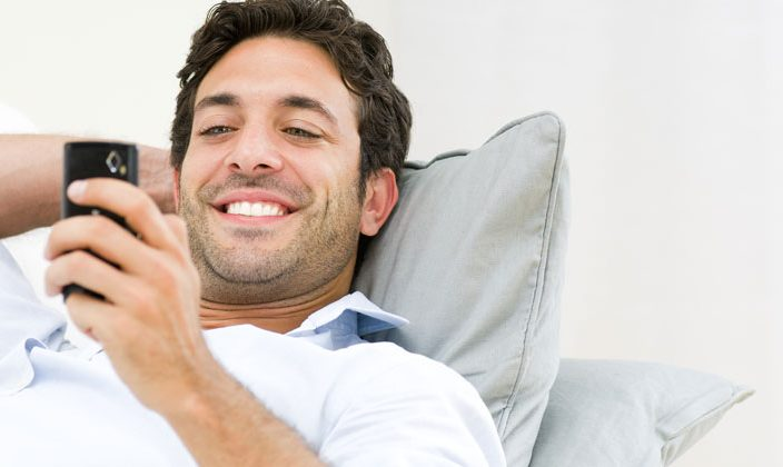 guy happy reading text message